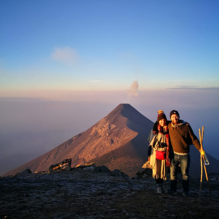 Backpacking as a couple - Watching the Volcan de Acatenango near Antigua, Guatemala erupt at sunrise