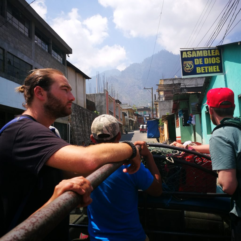 Riding in the back of a pick up truck from the village of Santa Clara to San Marcos, Lake Atitlan