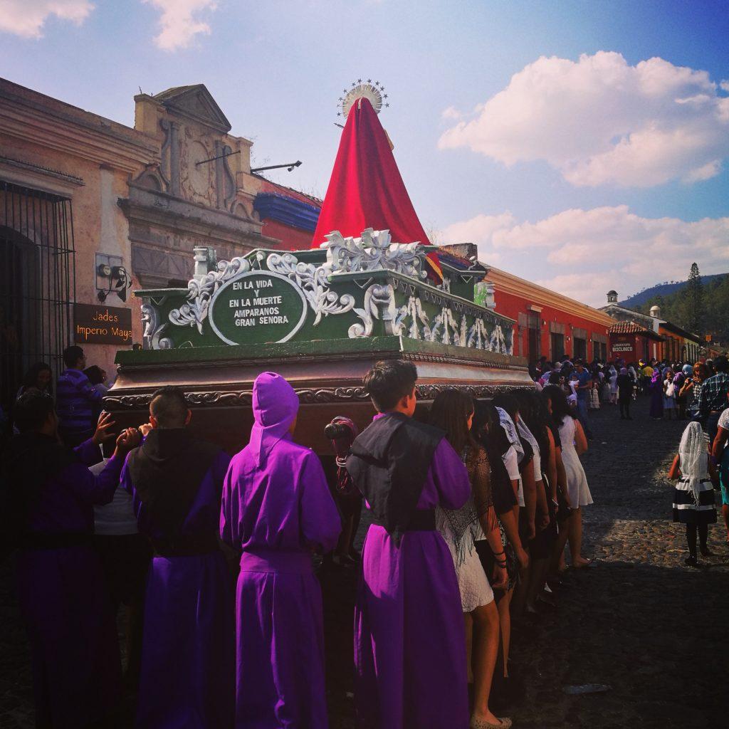 Locals carrying floats in the run up to Semana Santa, Antigua, Guatemala