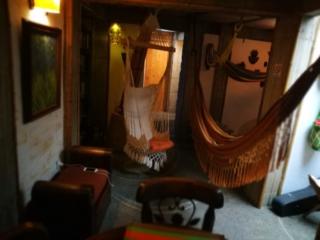 The cosy lounge & dining area inside of Kasaguadua, Salento, Colombia