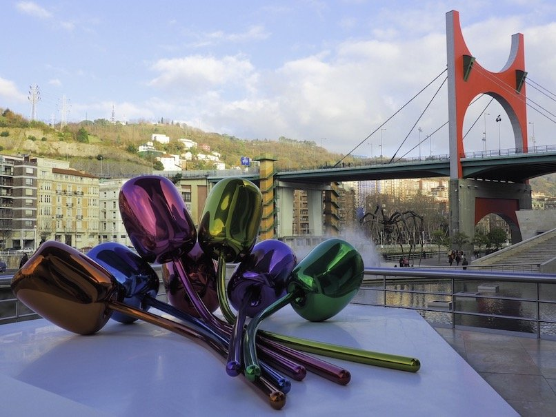 Why Visit Bilbao – Told Through Our Highlights - Tulips with Maman in the foreground at the Guggenheim - Destination Addict