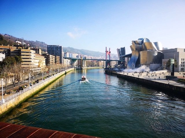 Why You Need To Why Visit Bilbao – Told Through Our Highlights - Taking in the views from one of the many bridges across the Arenal - Destination Addict