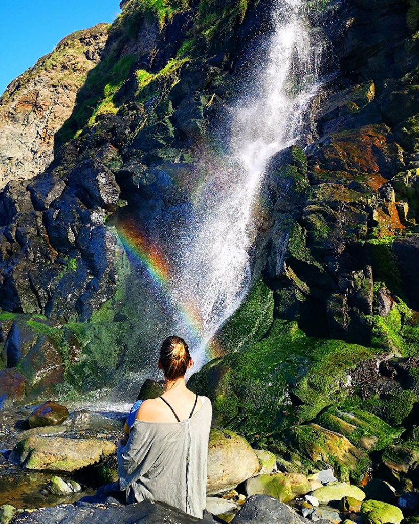 Beach waterfall at Tresaith - Van Life UK - Destination Addict