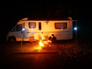 Having a fire outside the van in France, Europe